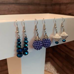 Three pairs of blue and white earrings